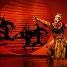 """Mukelisiwe Goba as """"Rafiki"""" in THE LION KING North American Tour. ©Disney. Photo by Matthew Murphy."""
